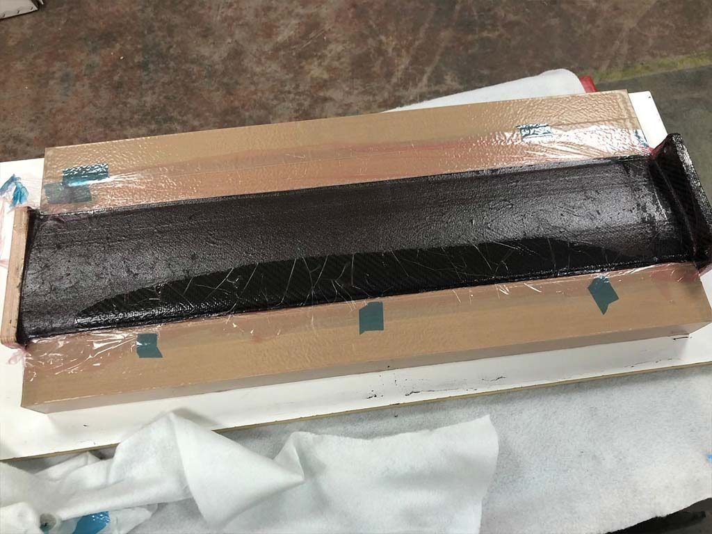 Cured carbon fibre part in the mould tool - NORCO Composites and GRP